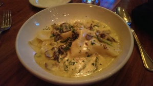 Lobster ravioli with asparagus and local mushrooms, with brandy, saffron and cream.